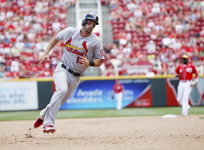 Aug 4, 2013; Cincinnati, OH, USA; St. Louis Cardinals second baseman Matt Carpenter (13) rounds third base during the ninth inning against the Cincinnati Reds at Great American Ball Park. The Cardinals defeated the Reds 15-2. Mandatory Credit: Frank Victores-USA TODAY Sports
