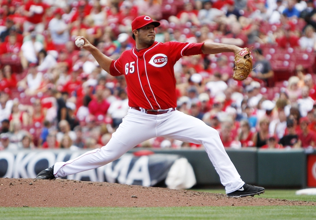 Aug 4, 2013; Cincinnati, OH, USA; Cincinnati Reds starting pitcher Pedro Villarreal (65) pitches during the eighth inning against the St. Louis Cardinals at Great American Ball Park. The Cardinals defeated the Reds 15-2. Mandatory Credit: Frank Victores-USA TODAY Sports