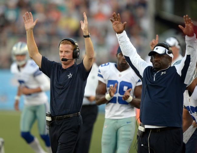 Aug 4, 2013; Canton, OH, USA; Dallas Cowboys coach Jason Garrett (left) and running backs coach Gary Brown celebrate after a touchdown in the first quarter against the Miami Dolphins in the 2013 Hall of Fame Game at Fawcett Stadium.  Mandatory Credit: Kirby Lee-USA TODAY Sports
