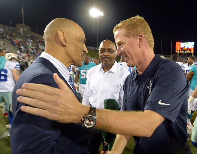 Aug 4, 2013; Canton, OH, USA; Dallas Cowboys coach Jason Garrett (right) shakes hands with Tony Dungy after the 2013 Hall of Fame Game against the Miami Dolphins at Fawcett Stadium. The Cowboys defeated the Dolphins 24-20.  Mandatory Credit: Kirby Lee-USA TODAY Sports