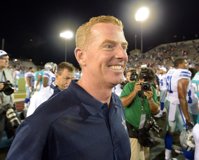 Aug 4, 2013; Canton, OH, USA; Dallas Cowboys coach Jason Garrett reacts after the 2013 Hall of Fame Game against the Miami Dolphins at Fawcett Stadium. The Cowboys defeated the Dolphins 24-20.  Mandatory Credit: Kirby Lee-USA TODAY Sports