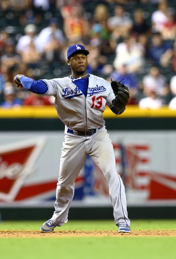 Jul. 9, 2013; Phoenix, AZ, USA: Los Angeles Dodgers shortstop Hanley Ramirez against the Arizona Diamondbacks at Chase Field. Mandatory Credit: Mark J. Rebilas-USA TODAY Sports
