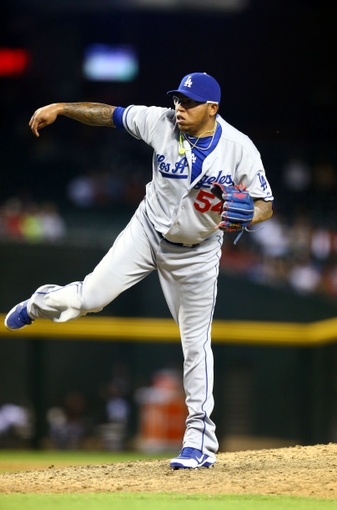 Jul. 9, 2013; Phoenix, AZ, USA: Los Angeles Dodgers pitcher Ronald Belisario against the Arizona Diamondbacks at Chase Field. Mandatory Credit: Mark J. Rebilas-USA TODAY Sports