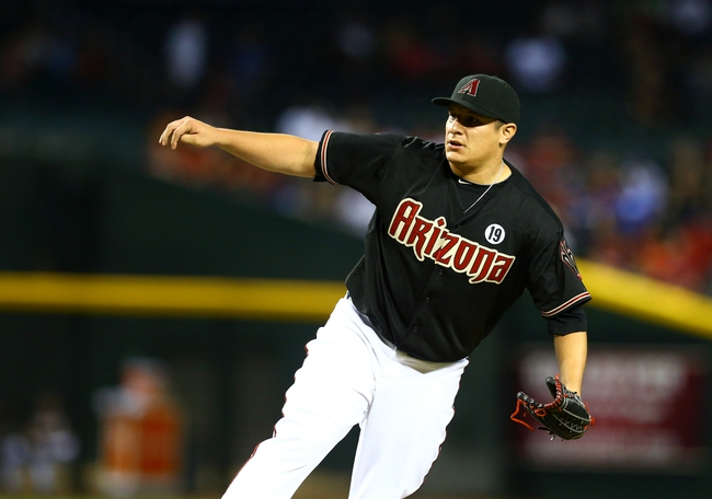 Jul. 9, 2013; Phoenix, AZ, USA: Arizona Diamondbacks pitcher David Hernandez against the Los Angeles Dodgers at Chase Field. Mandatory Credit: Mark J. Rebilas-USA TODAY Sports