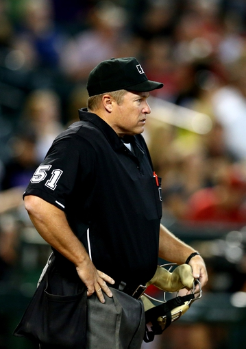 Jul. 9, 2013; Phoenix, AZ, USA: MLB umpire Marvin Hudson during the game between the Arizona Diamondbacks against the Los Angeles Dodgers at Chase Field. Mandatory Credit: Mark J. Rebilas-USA TODAY Sports
