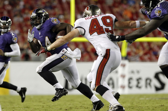 Aug 8, 2013; Tampa, FL, USA; Baltimore Ravens defensive back Mo Lee (34) runs with the ball as Tampa Bay Buccaneers linebacker Joe Holland (49) defends during the second half at Raymond James Stadium. Mandatory Credit: Kim Klement-USA TODAY Sports