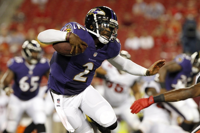 Aug 8, 2013; Tampa, FL, USA; Baltimore Ravens quarterback Tyrod Taylor (2) runs with the ball during the second half against the Tampa Bay Buccaneers at Raymond James Stadium. Mandatory Credit: Kim Klement-USA TODAY Sports