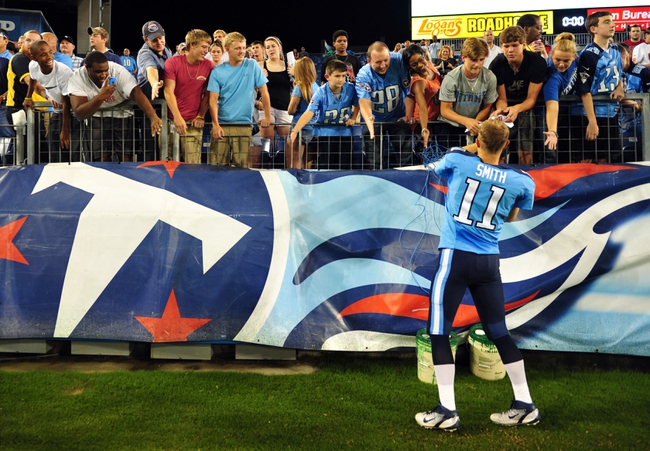 Aug 8, 2013; Nashville, TN, USA; Tennessee Titans fans greet Titans quarterback Rusty Smith (11) after a game against the Washington Redskins at LP Field. The Redskins beat the Titans 22-21. Mandatory Credit: Don McPeak-USA TODAY Sports