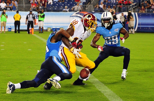 Aug 8, 2013; Nashville, TN, USA; Tennessee Titans cornerback Khalid Wooten (36) causes Washington Redskins wide receiver Lance Lewis (18) to fumble the ball at the goal line during the second half at LP Field. The Redskins beat the Titans 22-21. Mandatory Credit: Don McPeak-USA TODAY Sports