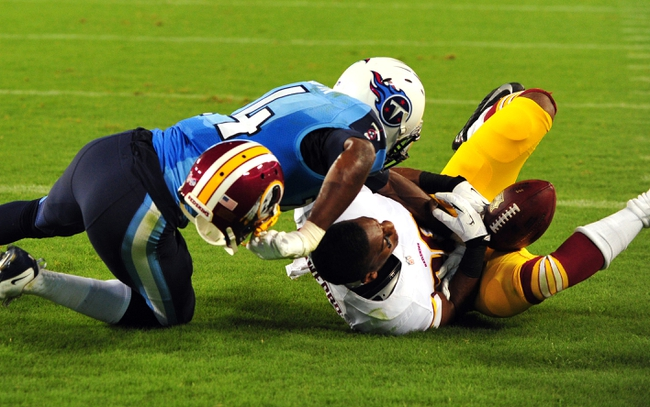 Aug 8, 2013; Nashville, TN, USA; Tennessee Titans wide receiver Michael Preston (14) collides with Washington Redskins cornerback Richard Crawford (20) in the end zone during the second half at LP Field. The Redskins beat the Titans 22-21. Mandatory Credit: Don McPeak-USA TODAY Sports