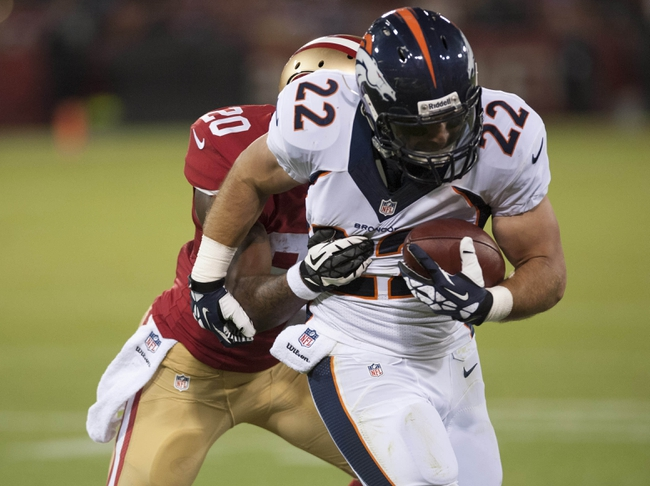 Aug 8, 2013; San Francisco, CA, USA; Denver Broncos running back Jacob Hester (22) runs with the ball against the San Francisco 49ers during the third quarter at Candlestick Park. Mandatory Credit: Ed Szczepanski-USA TODAY Sports