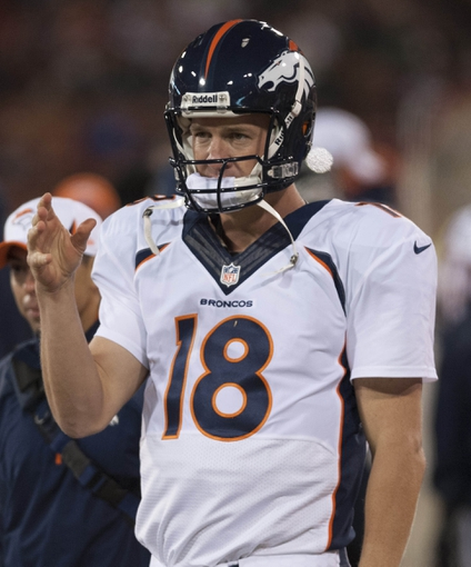 Aug 8, 2013; San Francisco, CA, USA; Denver Broncos quarterback Peyton Manning (18) motions for a ball on the sideline during the third quarter of the game against the San Francisco 49ers at Candlestick Park. Mandatory Credit: Ed Szczepanski-USA TODAY Sports