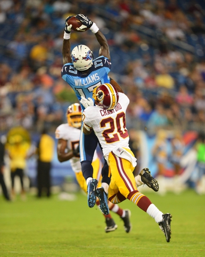 Aug 8, 2013; Nashville, TN, USA; Tennessee Titans wide receiver Damian Williams (17) catches a pass against Washington Redskins cornerback Richard Crawford (20) during the second half at LP Field. The Redskins beat the Titans 22-21. Mandatory Credit: Don McPeak-USA TODAY Sports
