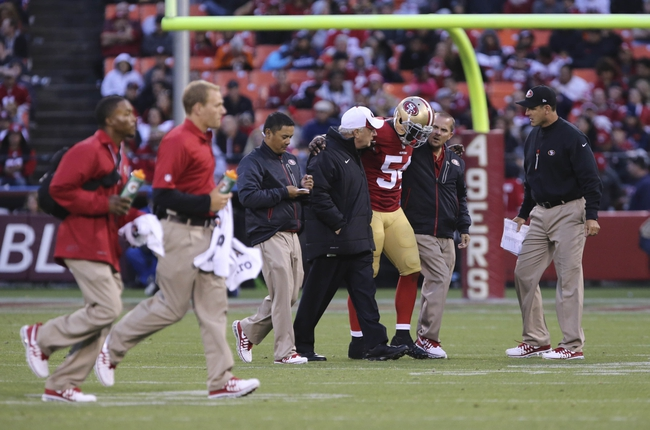 Aug 8, 2013; San Francisco, CA, USA; San Francisco 49ers outside linebacker Nick Moody (54) is escorted off the field during the third quarter against the Denver Broncos at Candlestick Park. The Denver Broncos defeated the San Francisco 49ers 10-6. Mandatory Credit: Kelley L Cox-USA TODAY Sports