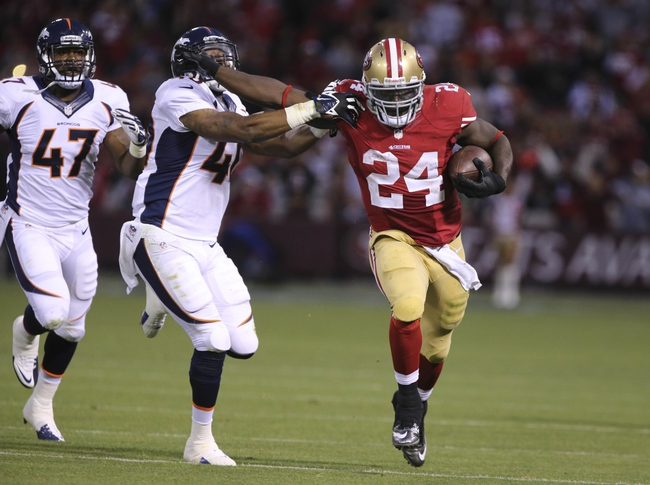 Aug 8, 2013; San Francisco, CA, USA; San Francisco 49ers running back Anthony Dixon (24) holds off Denver Broncos defensive back Aaron Hester (40) before the play is called back on a penalty during the fourth quarter at Candlestick Park. The Denver Broncos defeated the San Francisco 49ers 10-6. Mandatory Credit: Kelley L Cox-USA TODAY Sports