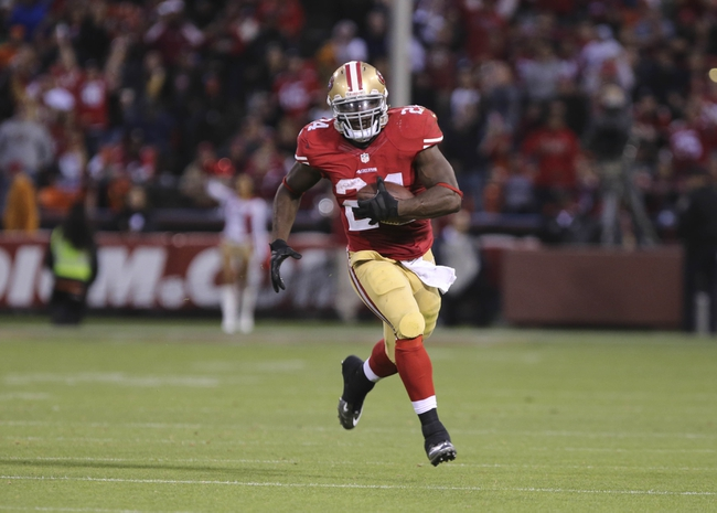 Aug 8, 2013; San Francisco, CA, USA; San Francisco 49ers running back Anthony Dixon (24) carries the ball before a penalty calls it back against the Denver Broncos during the fourth quarter at Candlestick Park. The Denver Broncos defeated the San Francisco 49ers 10-6. Mandatory Credit: Kelley L Cox-USA TODAY Sports