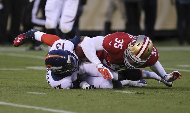 Aug 8, 2013; San Francisco, CA, USA; San Francisco 49ers safety Eric Reid (35) tackles Denver Broncos wide receiver Kemonte' Bateman (13) during the third quarter at Candlestick Park. The Denver Broncos defeated the San Francisco 49ers 10-6. Mandatory Credit: Kelley L Cox-USA TODAY Sports