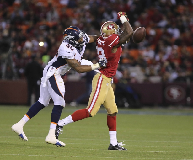 Aug 8, 2013; San Francisco, CA, USA; Denver Broncos defensive back Aaron Hester (40) is called for pass inter fence against San Francisco 49ers wide receiver Ricardo Lockette (18) during the fourth quarter at Candlestick Park. The Denver Broncos defeated the San Francisco 49ers 10-6. Mandatory Credit: Kelley L Cox-USA TODAY Sports