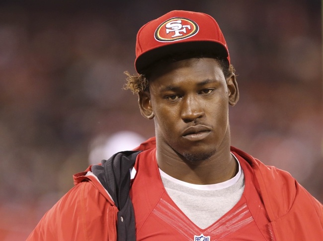 Aug 8, 2013; San Francisco, CA, USA; San Francisco 49ers linebacker Aldon Smith (99) on the sideline during the fourth quarter against the Denver Broncos at Candlestick Park. The Denver Broncos defeated the San Francisco 49ers 10-6. Mandatory Credit: Kelley L Cox-USA TODAY Sports