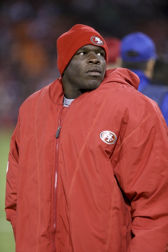 Aug 8, 2013; San Francisco, CA, USA; San Francisco 49ers running back Frank Gore (21) on the sideline during the fourth quarter against the Denver Broncos at Candlestick Park. The Denver Broncos defeated the San Francisco 49ers 10-6. Mandatory Credit: Kelley L Cox-USA TODAY Sports