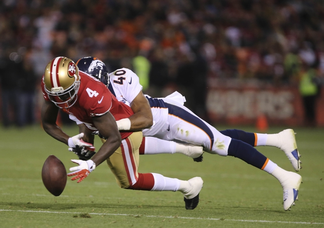 Aug 8, 2013; San Francisco, CA, USA; Denver Broncos defensive back Aaron Hester (40) prevents the pass intended for San Francisco 49ers wide receiver Lavelle Hawkins (4) during the fourth quarter at Candlestick Park. The Denver Broncos defeated the San Francisco 49ers 10-6. Mandatory Credit: Kelley L Cox-USA TODAY Sports