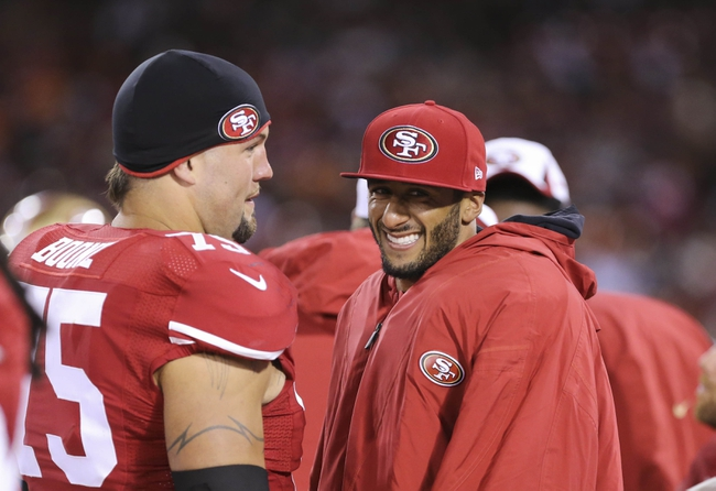 Aug 8, 2013; San Francisco, CA, USA; San Francisco 49ers quarterback Colin Kaepernick (7) smile with guard Alex Boone (75) on the sideline during the fourth quarter against the Denver Broncos at Candlestick Park. The Denver Broncos defeated the San Francisco 49ers 10-6. Mandatory Credit: Kelley L Cox-USA TODAY Sports