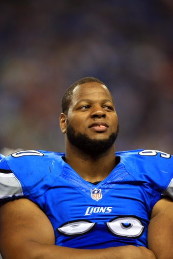Aug 9, 2013; Detroit, MI, USA; Detroit Lions defensive tackle Ndamukong Suh (90) on the sidelines in the third quarter of a preseason game against the New York Jets at Ford Field. Mandatory Credit: Andrew Weber-USA TODAY Sports