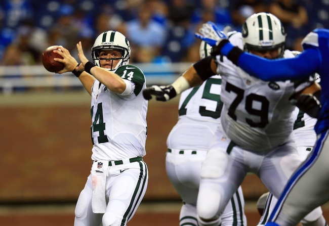 Aug 9, 2013; Detroit, MI, USA; New York Jets quarterback Greg McElroy (14) throws a pass in the third quarter of a preseason game against the Detroit Lions at Ford Field. Mandatory Credit: Andrew Weber-USA TODAY Sports