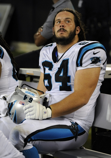 Aug 9, 2013; Charlotte, NC, USA; Carolina Panthers center Brian Folkerts (69) cools down on the sidelines during the game against the Chicago Bears at Bank of America Stadium.  Mandatory Credit: Sam Sharpe-USA TODAY Sports