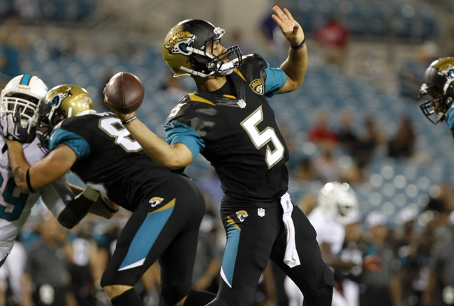Aug 9, 2013; Jacksonville, FL, USA; Jacksonville Jaguars quarterback Matt Scott (5) throws the ball during the second half against the Miami Dolphins at EverBank Field. Miami Dolphins defeated the Jacksonville Jaguars 27-3. Mandatory Credit: Kim Klement-USA TODAY Sports