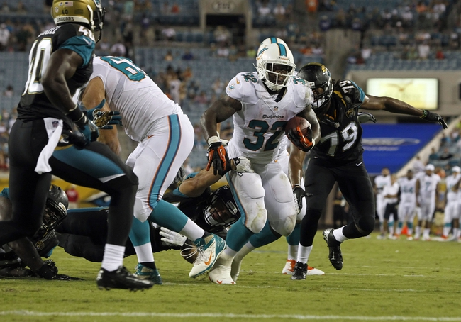 Aug 9, 2013; Jacksonville, FL, USA;Miami Dolphins running back Jonas Gray (32) runs with the ball in the red zone during the second half against the Jacksonville Jaguars at EverBank Field. Miami Dolphins defeated the Jacksonville Jaguars 27-3. Mandatory Credit: Kim Klement-USA TODAY Sports