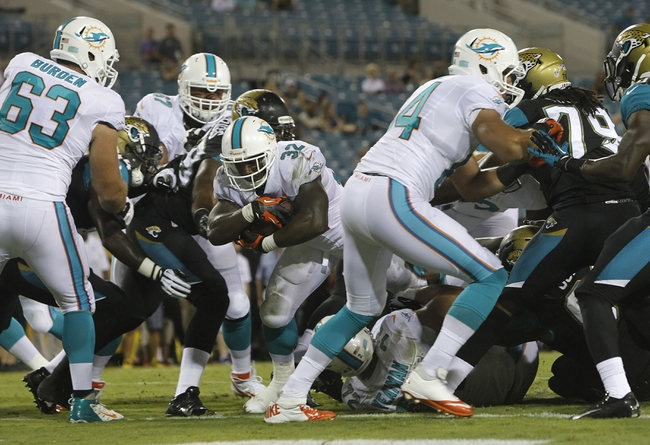 Aug 9, 2013; Jacksonville, FL, USA; Miami Dolphins running back Jonas Gray (32) runs the ball in for a touchdown during the second half against the Jacksonville Jaguars at EverBank Field. Miami Dolphins defeated the Jacksonville Jaguars 27-3. Mandatory Credit: Kim Klement-USA TODAY Sports