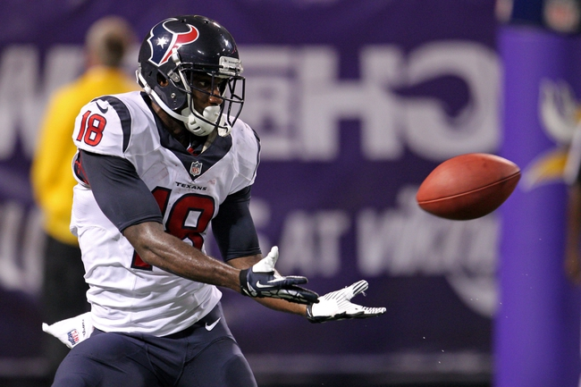 Aug 9, 2013; Minneapolis, MN, USA; Houston Texans wide receiver Lestar Jean (18) catches a touchdown pass during the fourth quarter against the Minnesota Vikings at the Metrodome. Mandatory Credit: Brace Hemmelgarn-USA TODAY Sports