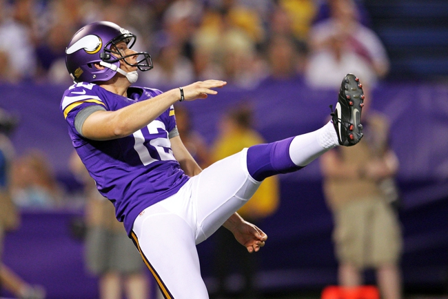 Aug 9, 2013; Minneapolis, MN, USA; Minnesota Vikings punter Jeff Locke (12) punts during the fourth quarter against the Houston Texans at the Metrodome. Mandatory Credit: Brace Hemmelgarn-USA TODAY Sports