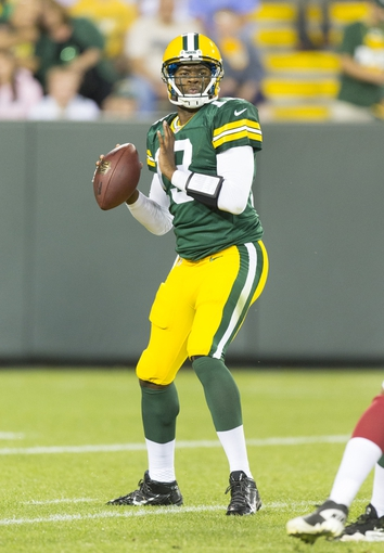 Aug 9, 2013; Green Bay, WI, USA; Green Bay Packers quarterback Vince Young (13) drops back to pass during the fourth quarter against the Arizona Cardinals at Lambeau Field.  The Cardinals won 17-0.  Mandatory Credit: Jeff Hanisch-USA TODAY Sports