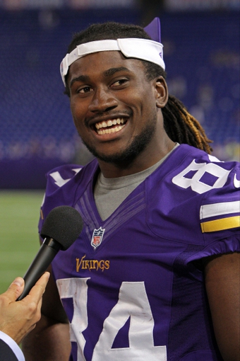 Aug 9, 2013; Minneapolis, MN, USA; Minnesota Vikings wide receiver Cordarrelle Patterson (84) smiles during an interview following the game against the Houston Texans at the Metrodome. The Texans defeated the Vikings 27-13. Mandatory Credit: Brace Hemmelgarn-USA TODAY Sports