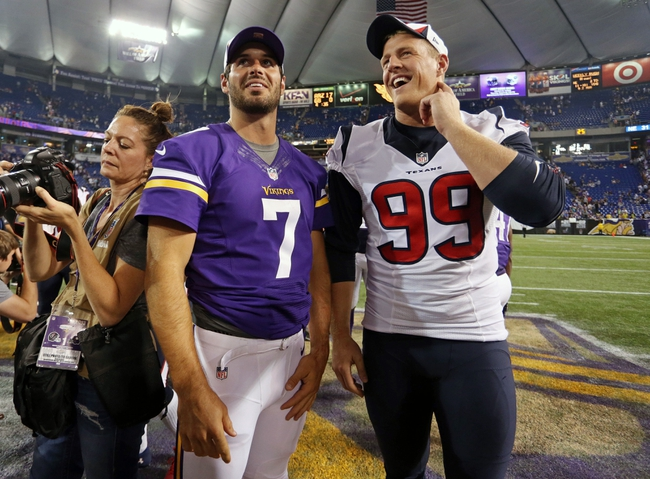 Aug 9, 2013; Minneapolis, MN, USA; Minnesota Vikings quarterback Christian Ponder (7) and Houston Texans defensive tackle Daniel Muir (99) talk after the game at the Metrodome. The Texans won 27-13. Mandatory Credit: Jesse Johnson-USA TODAY Sports