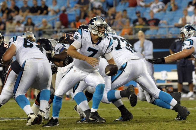 Aug 9, 2013; Charlotte, NC, USA; Carolina Panthers quarterback Jimmy Clausen (7) prepares to hand the ball off while playing against the Chicago Bears at Bank of America Stadium.  Carolina wins 24-17. Mandatory Credit: Sam Sharpe-USA TODAY Sports