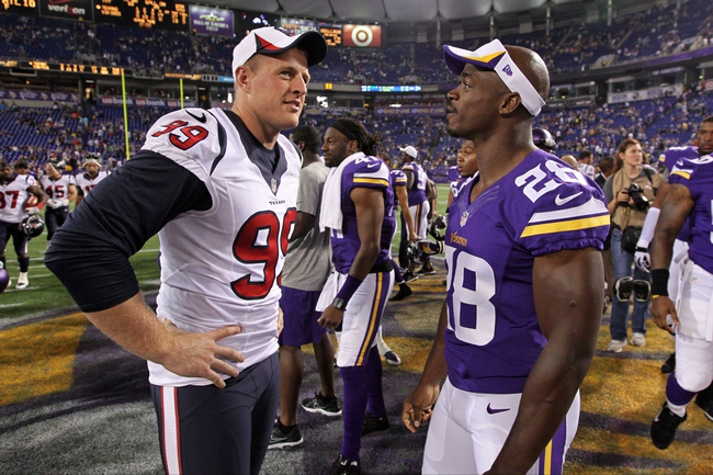 Aug 9, 2013; Minneapolis, MN, USA; Houston Texans defensive end J.J. Watt (99) talks with Minnesota Vikings running back Adrian Peterson (28) following the game at the Metrodome. The Texans defeated the Vikings 27-13. Mandatory Credit: Brace Hemmelgarn-USA TODAY Sports