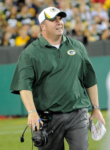 Aug 9, 2013; Green Bay, WI, USA;  Green Bay Packers head coach Mike McCarthy can only laugh in the last minutes of the game against the Arizona Cardinals at Lambeau Field. The Cardinals beat the Packers 17-0.  Mandatory Credit: Benny Sieu-USA TODAY Sports