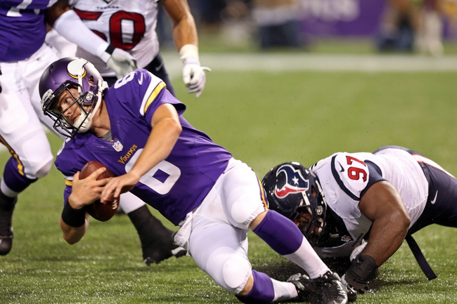 Aug 9, 2013; Minneapolis, MN, USA; Minnesota Vikings quarterback James Vandenberg (6) gets sacked by Houston Texans defensive tackle Terrell McClain (97) in the second half at the Metrodome. The Texans won 27-13. Mandatory Credit: Jesse Johnson-USA TODAY Sports
