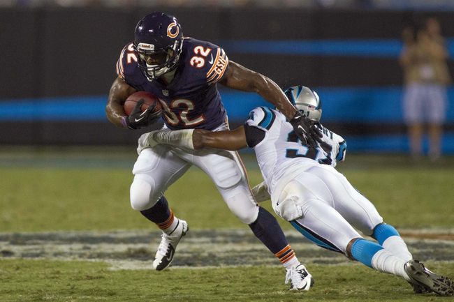 Aug 9, 2013; Charlotte, NC, USA; Chicago Bears running back Michael Ford (32) runs the ball before being tackled by Carolina Panthers defensive back James Dockery (31) during the second half against the. The Panthers defeated the Bears 24-17. Mandatory Credit: Jeremy Brevard-USA TODAY Sports