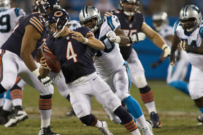 Aug 9, 2013; Charlotte, NC, USA; Chicago Bears quarterback Matt Blanchard (4) is sacked by Carolina Panthers defensive end Louis Nzegwu (50) during the second half against the. The Panthers defeated the Bears 24-17. Mandatory Credit: Jeremy Brevard-USA TODAY Sports