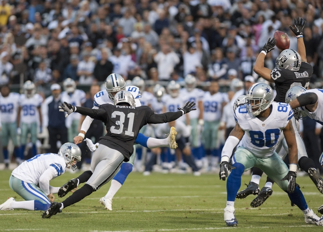 Aug 9, 2013; Oakland, CA, USA; Oakland Raiders wide receiver Isaiah Williams (83) blocks a field goal attempt during the second quarter of the game against the Dallas Cowboys at O.Co Coliseum. Mandatory Credit: Ed Szczepanski-USA TODAY Sports