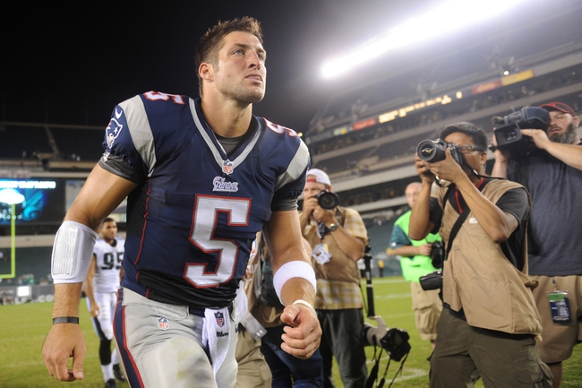 Aug 9, 2013; Philadelphia, PA, USA; New England Patriots quarterback Tim Tebow (5) leaves the field after the second half of a preseason game against the Philadelphia Eagles at Lincoln Financial Field. The Patriots won 31-22. Mandatory Credit: Joe Camporeale-USA TODAY Sports