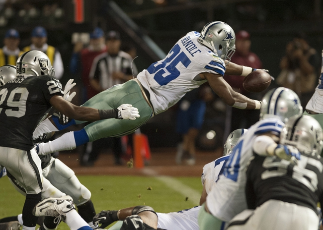 Aug 9, 2013; Oakland, CA, USA; Dallas Cowboys running back Joseph Randle (35) dives for a touchdown during the fourth quarter at O.Co Coliseum. The Oakland Raiders defeated the Dallas Cowboys 19-17. Mandatory Credit: Ed Szczepanski-USA TODAY Sports