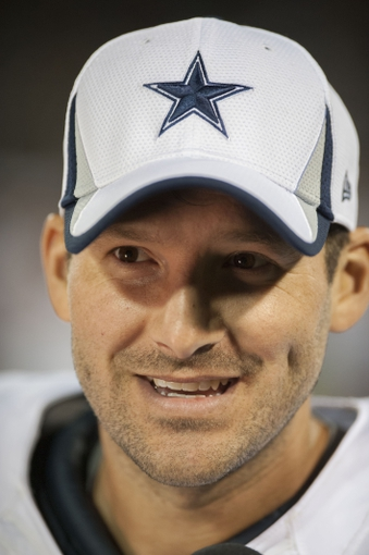 Aug 9, 2013; Oakland, CA, USA; Dallas Cowboys quarterback Tony Romo (9) answers questions in an interview during the game against the Oakland Raiders at O.Co Coliseum. The Oakland Raiders defeated the Dallas Cowboys 19-17. Mandatory Credit: Ed Szczepanski-USA TODAY Sports