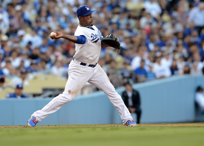 Aug 11, 2013; Los Angeles, CA, USA;   Los Angeles Dodgers third baseman Juan Uribe (5) throws to second to start a double play in the fifth inning the game against the Tampa Bay Rays at Dodger Stadium. Mandatory Credit: Jayne Kamin-Oncea-USA TODAY Sports