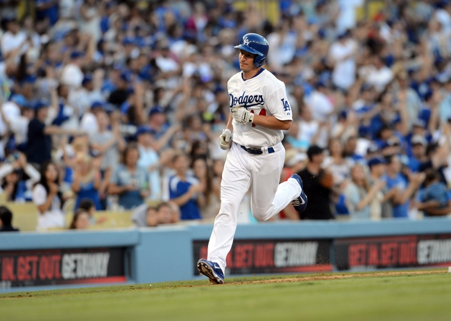 Aug 11, 2013; Los Angeles, CA, USA;    Los Angeles Dodgers second baseman Mark Ellis (13) rounds the bases after a two-run home run in the sixth inning against the Tampa Bay Rays at Dodger Stadium. Mandatory Credit: Jayne Kamin-Oncea-USA TODAY Sports