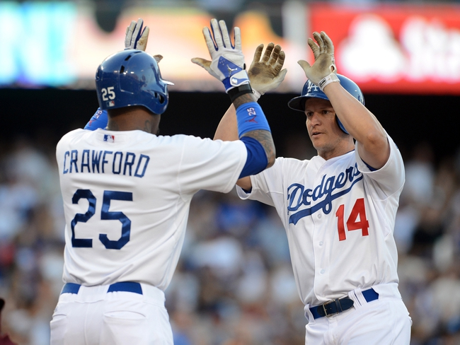 Aug 11, 2013; Los Angeles, CA, USA;    Los Angeles Dodgers second baseman Mark Ellis (13) high fives left fielder Carl Crawford (25) after a 2 run home run in the sixth inning against the Tampa Bay Rays at Dodger Stadium. Mandatory Credit: Jayne Kamin-Oncea-USA TODAY Sports